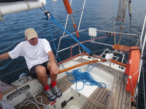 Michael Vaughan sailing Island Vertue in Hobart complete with Vertue T-shirt